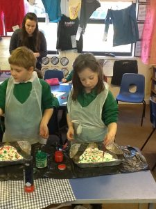 Using paint and shaving foam to paint bunting for the Eisteddfod