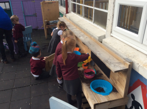 Making food in our mud kitchen!