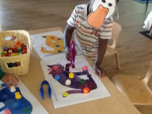 We use our fine motor skills to pick up objects and move them.