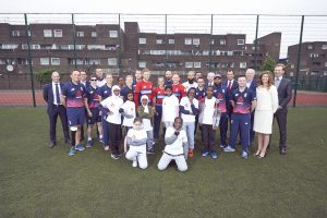 LONDON, ENGLAND - MAY 08: In this handout image provided by NatWest England Players Joe Root (5th From left, centre row), Heather Knight(4th from left centre row), Iain Nairn (Far Left centre row) and Moeen Ali (6th from right, back row) are joined by former players Andrew Strauss (Far left, back row) and Michael Vaughan (3rd from left, back row), also Tom Harrison (ECB CEO, 3rd from right, back row) and David Wheldon (RBS CMO, 2nd from right, Back row), plus children from Vauxhall Primary school at the NatWest 'Cricket has no boundaries' campaign launch at the Black Prince Community Trust Hub on May 1, 2017 in Vauxhall,London. (Photo by Handout/Getty Images)