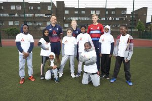 LONDON, ENGLAND - MAY 08: In this handout image provided by NatWest England Players Joe Root (Back right)), Heather Knight (centre back), Iain Nairn (Left back)  are joined by children from Vauxhall Primary school  at the NatWest 'Cricket has no boundaries' campaign launch at the Black Prince Community Trust Hub on May 1, 2017 in Vauxhall,London. (Photo by Handout/Getty Images)